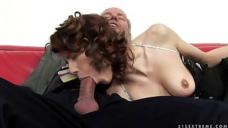 A cute redhead fingers an old man's ass hole